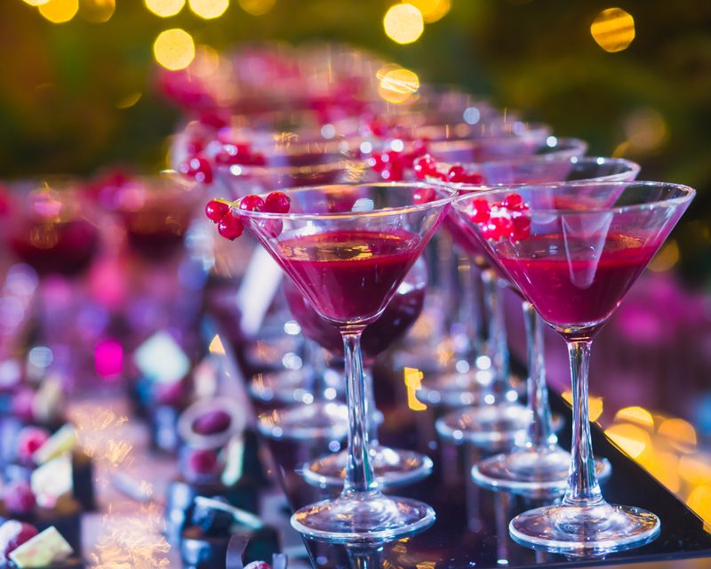 Martini glasses filled with a colourful drink